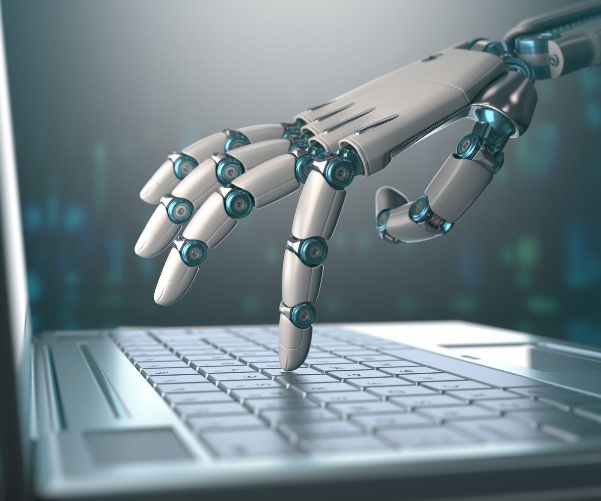robot hand touching laptop