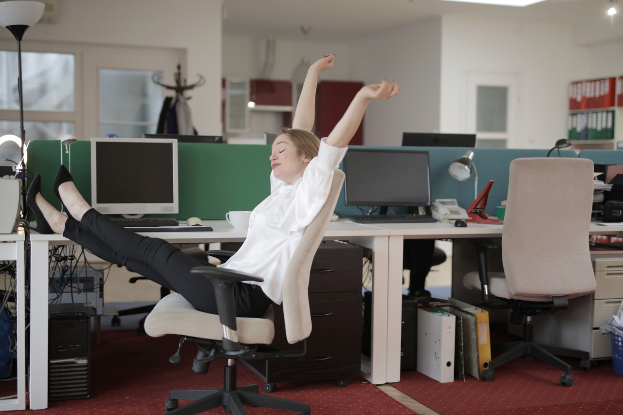 woman stretching at work