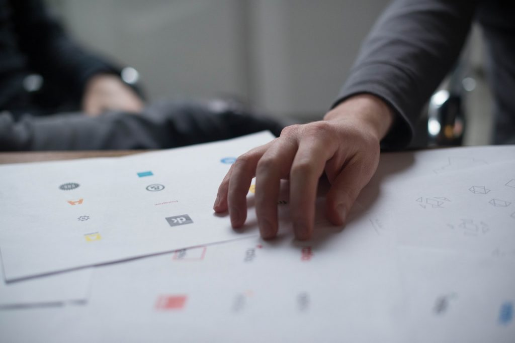 hands on paper with brand logos
