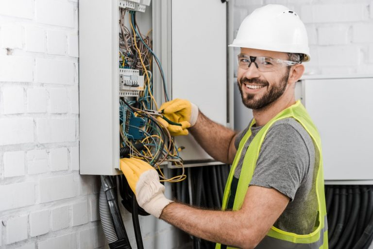 man working on house fuse box