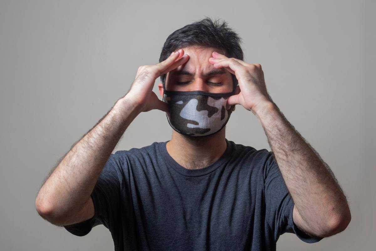 man with face mask stressed